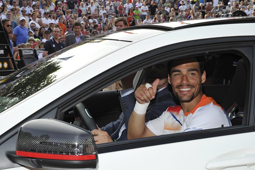 Dopo due finali perse, il momento di conquistare finalmente un titolo ATP è arrivato nel 2013 alla Mercedes Cup di Stoccarda, nella penultima edizione disputata sulla terra battuta prima della saggia scelta degli organizzatori di passare all'erba. L'allora 26enne Fognini vinse quattro match in due set, poi ne rimontò uno al padrone di casa Philipp Kohlschreiber e chiuse 5-7 6-4 6-4, conquistando la fuoriserie Mercedes in palio per il campione, e soprattutto lanciando una serie di 13 vittorie di fila che l'avrebbe portato fra i primi 20 ATP. Anche il grande pubblico iniziò a conoscerlo, anche perché…